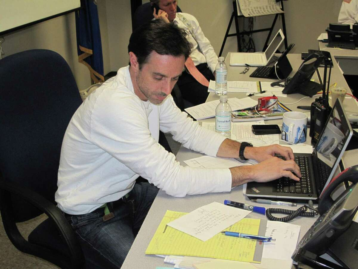 Former New Canaan Director of Emergency Management Michael Handler works in the town's Emergency Operations Center in a previous year with an outcall system from a vendor it has been using, Blackboard. The town has launched a new emergency notifications service platform called Everbridge this week.