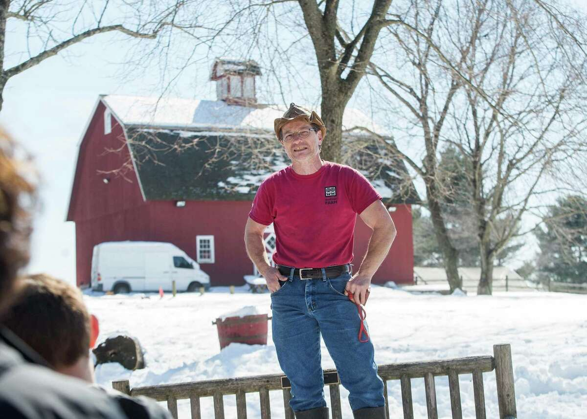 Kevin Meehan describes the sugar mapling process to visitors of Ambler Farm.