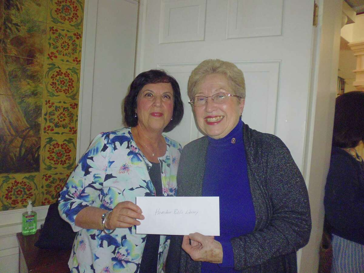 The Hamden Rotary Club's Community Service Committee donated $1,500 to the Hamden Public Library. The funds were used to purchase books, guides, kits, and supplies to enable the library to assist local families with homeschooling needs. Rotarian Lynn Campo, right, presented the check to recently retired library director Marian Amodeo.