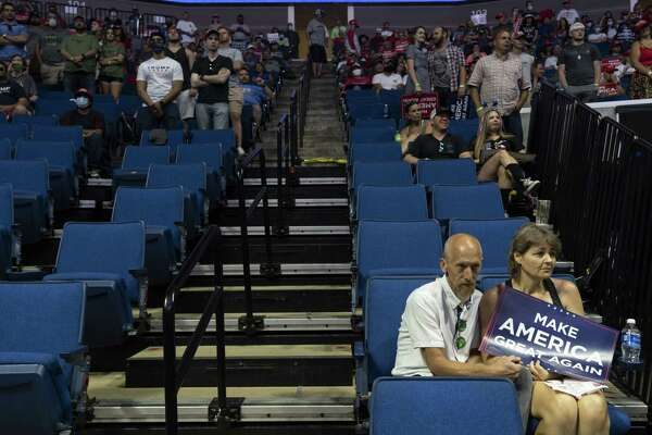 Attendees listen during a rally for President Donald Trump in Tulsa, Okla., on Saturday, June 20, 2020.