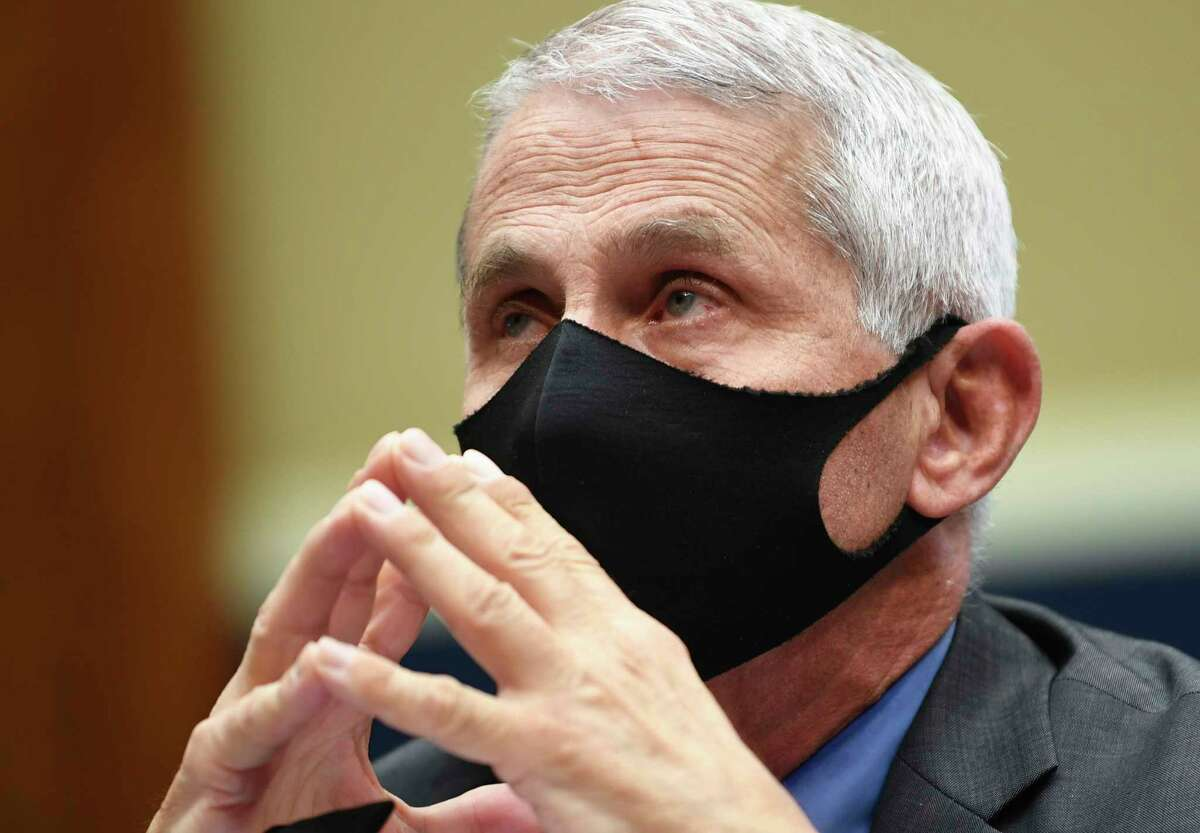 Director of the National Institute of Allergy and Infectious Diseases Dr. Anthony Fauciwears a face mask as he waits to testify before a House Committee on Energy and Commerce on the Trump administration's response to the COVID-19 pandemic on Capitol Hill in Washington on Tuesday, June 23, 2020. (Kevin Dietsch/Pool via AP)