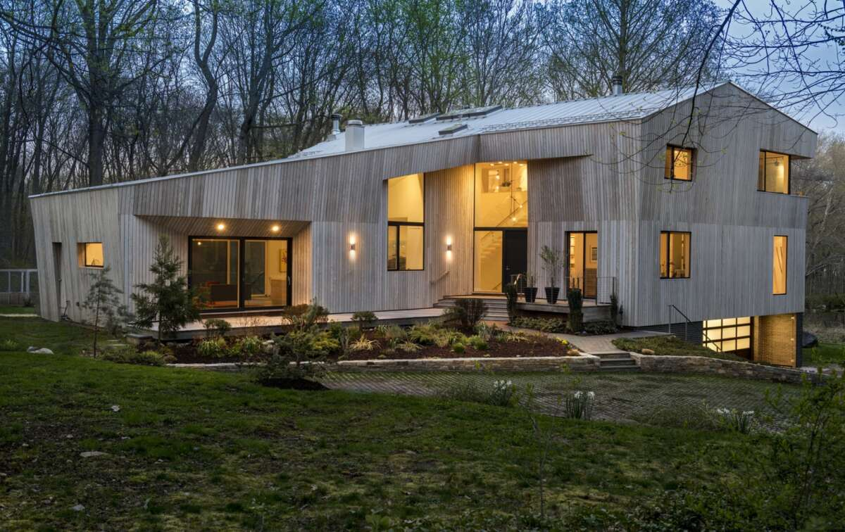 On the market for $2,995,000, this 6,632 sqft contemporary home in Darien boasts five bedrooms, six bathrooms and sits on 2.18 acres of land. The house was designed by a Brooklyn-based firm called su11 architecture+design and was built in 2011 by Prutting & Company.