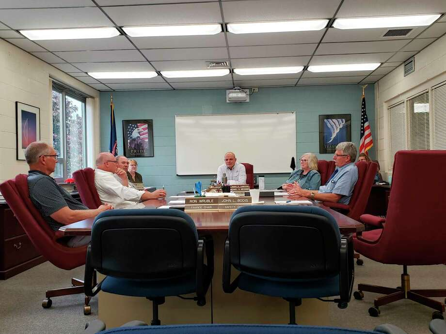 The Huron County Board of Commissioners talk before this week's meeting. It was the first meeting the commissioners held in the county building's conference room since March. (Robert Creenan/Huron Daily Tribune)