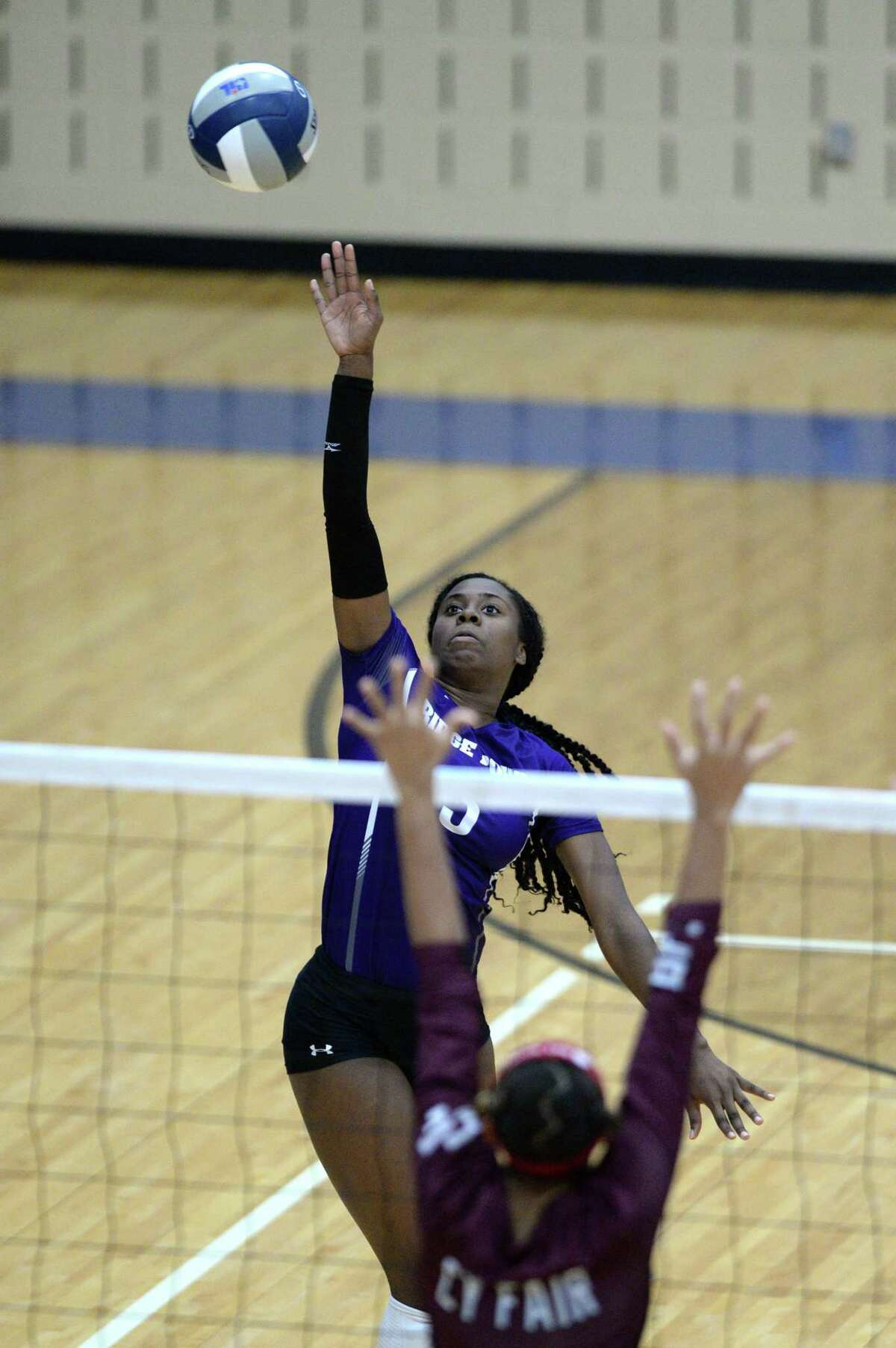 Tiana Davis (5) of Ridge Point hits a shot during the third set of the Region III-6A Final volleyball match between the Ridge Point Panthers and the Cy-Fair Bobcats on Saturday, November 16, 2019 at Wheeler Fieldhouse, Sugar Land, TX.