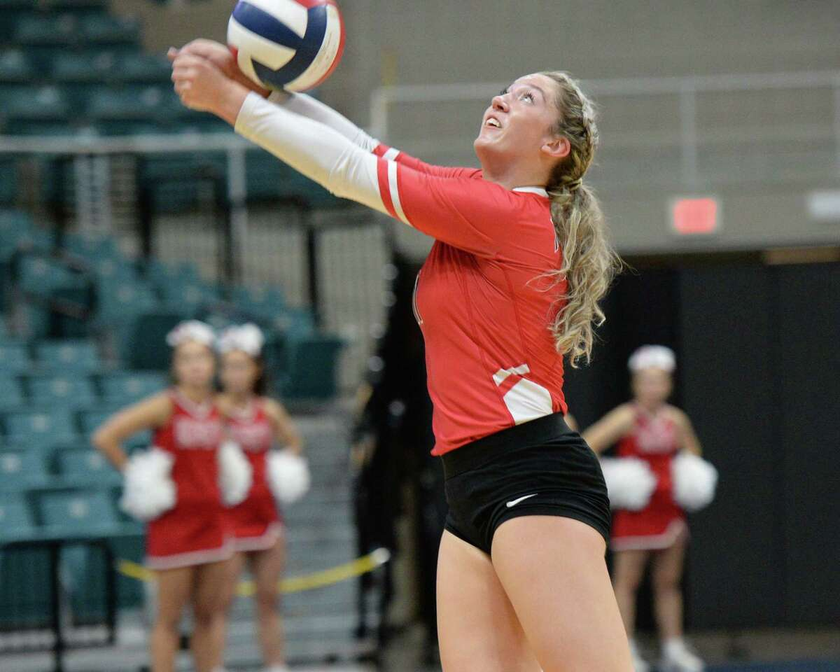 Hannah Hoover (11) of Katy digs for a ball during the fourth set of a Class 6A Region III bi-district volleyball playoff match between the Dulles Vikings and the Katy Tigers on Monday, November 4, 2019 at the Leonard Merrell Center, Katy, TX.