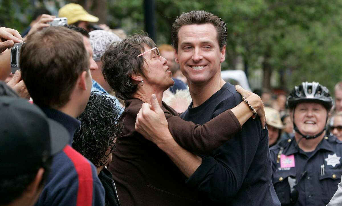 Then-Mayor Gavin Newsom gets an enthusiastic greeting on Market Street at the 2005 Pride Parade.