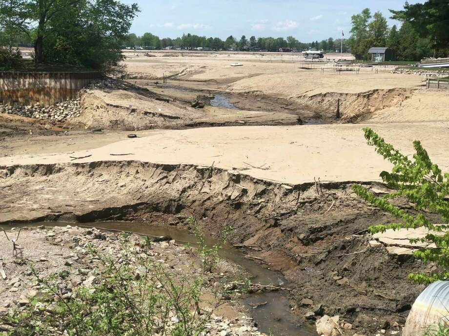 This photo, taken about two and a half miles from the Edenville Dam, shows trenches that were eroded into the lake bottom lands after last month's devastating flooding. (Photo by Kate Hessling/khessling@hearstnp.com)