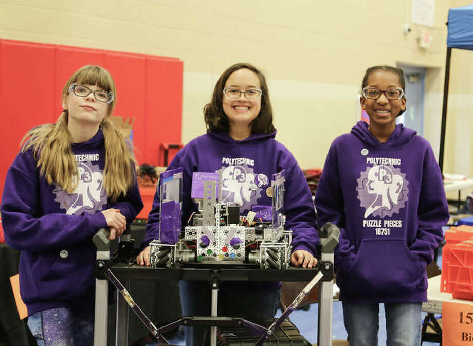 Girl Scouts display a robot they designed, built and programmed for competition in FIRST Tech Challenge robotics league. Photo: For The Telegraph