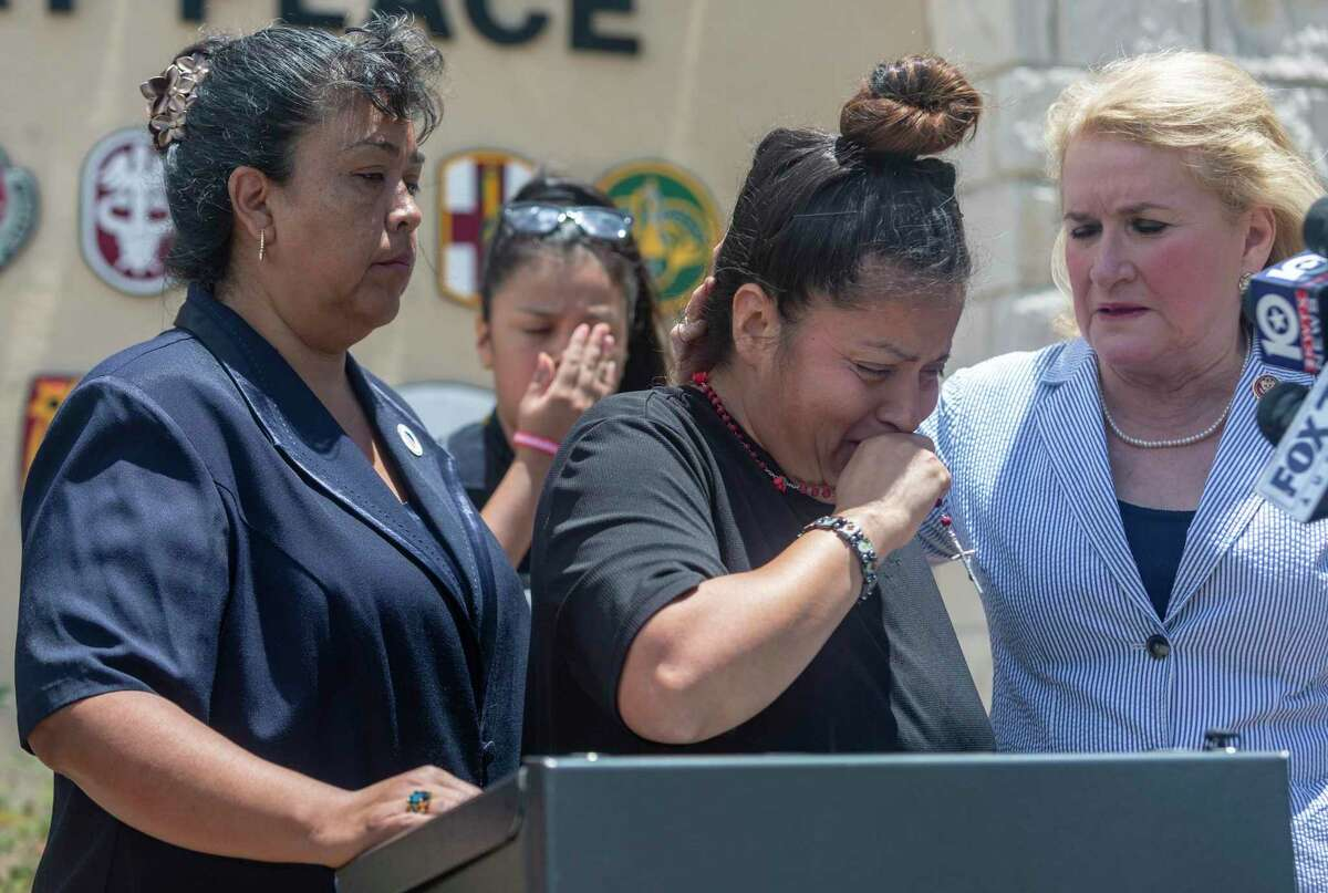 Gloria Guillen, center, is comforted Tuesday in Killeen by U.S. Rep. Sylvia Garcia, D-Houston, right, and LULAC District 17 representative AnaLuisa Tapia after she spoke at the Fort Hood main gate about her missing daughter, Pfc. Vanessa Guillen.