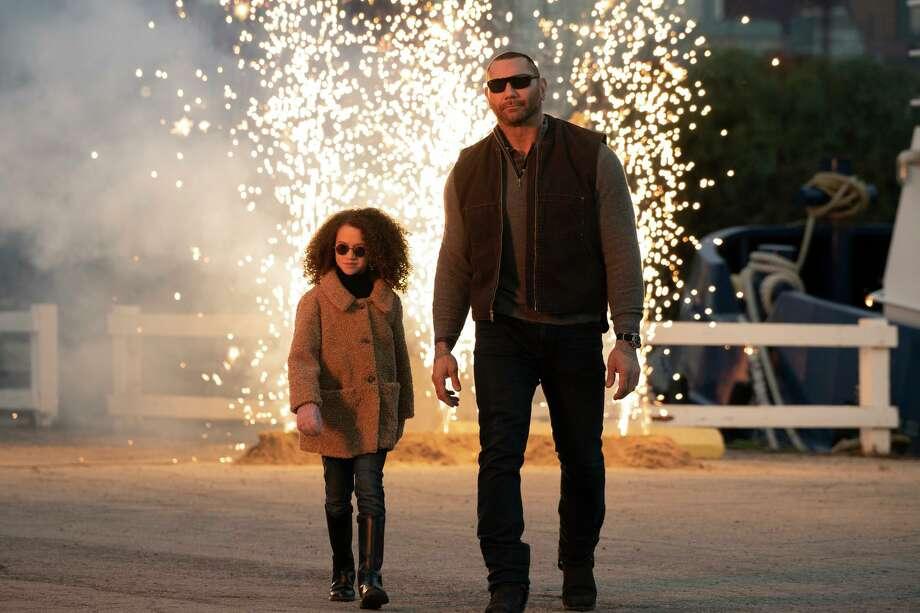 "Dave Bautista and Chloe Coleman bond in ""My Spy."" Photo: Amazon Studios"