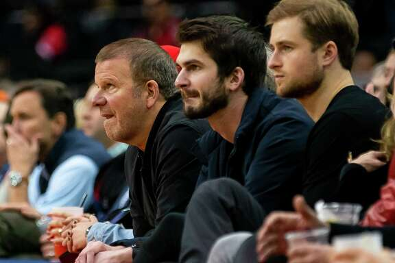 Houston Rockets owner Tilman Fertitta, watching a Rockets game in December, said the NBA should expect positive tests for COVID-19 upon its return but will have to deal with it and move on.