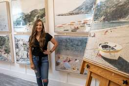Kayla Barker poses by her photo encaustic art Tuesday, June 23, 2020 at her studio in Midland.