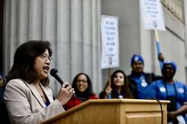 Oakland city council member Nikki Fortunato Bas speaking during a 2019 rally in support of more city hiring. Bas is sponsoring a ballot measure to restructure the city's tax structure to raise more revenue.