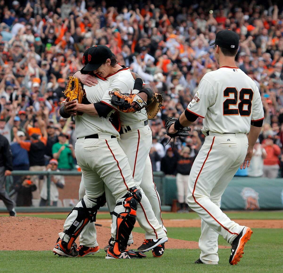 Pitcher Tim Lincecum, center, is mobbed by teammates after he pitched a no hitter as the San Francisco Giants played the San Diego Padres at AT&T Park in San Francisco, Calif., on Wednesday, June 25, 2014, defeating the Padres 4-0.