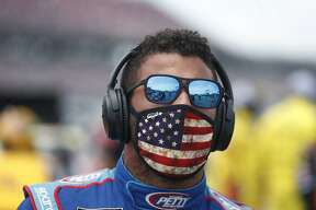 Driver Bubba Wallace prior to the start of the NASCAR Cup Series at the Talladega Superspeedway in Talladega, Ala., Monday, June 22, 2020. (AP Photo/John Bazemore)