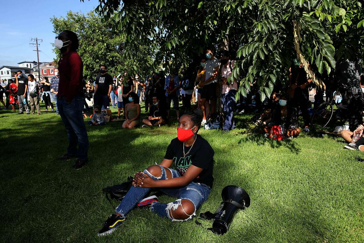 Aniya Butler, 14, a freshman at Oakland Charter High School, attends a Juneteenth demonstration at DeFremery Park on Friday, June 19, 2020, in West Oakland, Calif. Butler is an activist with Youth vs. Apocalypse.