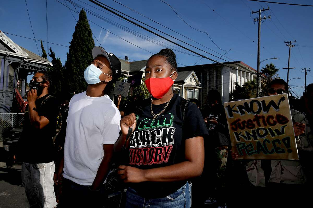Aniya Butler, 14, a freshman at Oakland Charter High School, participates in a Juneteenth demonstration as she marches along Adeline St. on Friday, June 19, 2020, in West Oakland, Calif. Butler is an activist with Youth vs. Apocalypse.