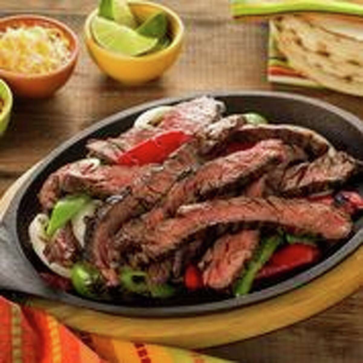 Tex-Mex Fajitas:Marinate your skirt steak at home and put it in your cooler for your weekend camping trip! Here's what you'll need 1. 2 lbs. Skirt Steak, trimmed 2. 1 sliced onion 3. 1 sliced bell pepper 4. flour tortillas 5. ½ cup Italian dressing 6. ½ cup apple cider vinegar 7. ½ cup soy sauce 8. 1/3 cup Worcestershire sauce 9. 1/3 cup brown sugar 10. 2 Tbsp. lime juice 11. Dash of garlic powder or crushed fresh garlic.