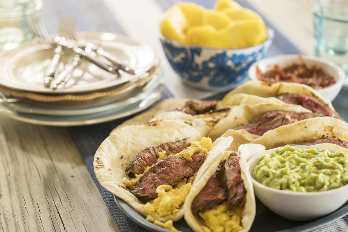 Steak Fajita Breakfast Tacos:You won't even need dishes for this one! Here's what you'll need 1. Steak from Traditional Tex-Mex Fajitas 2. 4 eggs 3. 4 flour tortillas 5. Toppings of your choice!