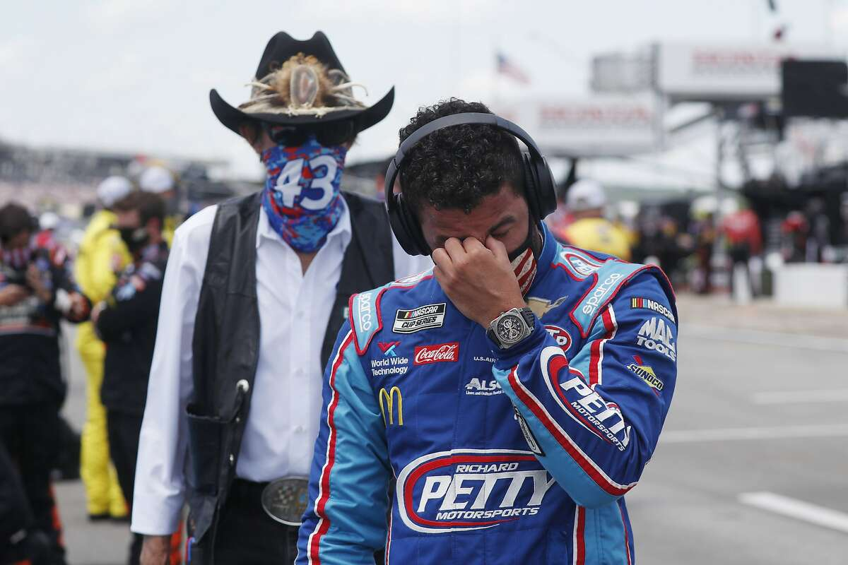 Team owner Richard Petty, left watches as driver Bubba Wallace wipes away tears prior to the start of the NASCAR Cup Series at the Talladega Superspeedway in Talladega, Ala., Monday, June 22, 2020. (AP Photo/John Bazemore)