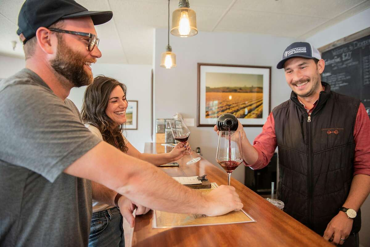 Jake Tishler of Los Angeles and Molly Hersh of Santa Ynez get poured a taste of the 2015 Dragonette Syrah from tasting room manager Nick Luis on Sunday, April 14, 2019, in Los Olivos, Ca.