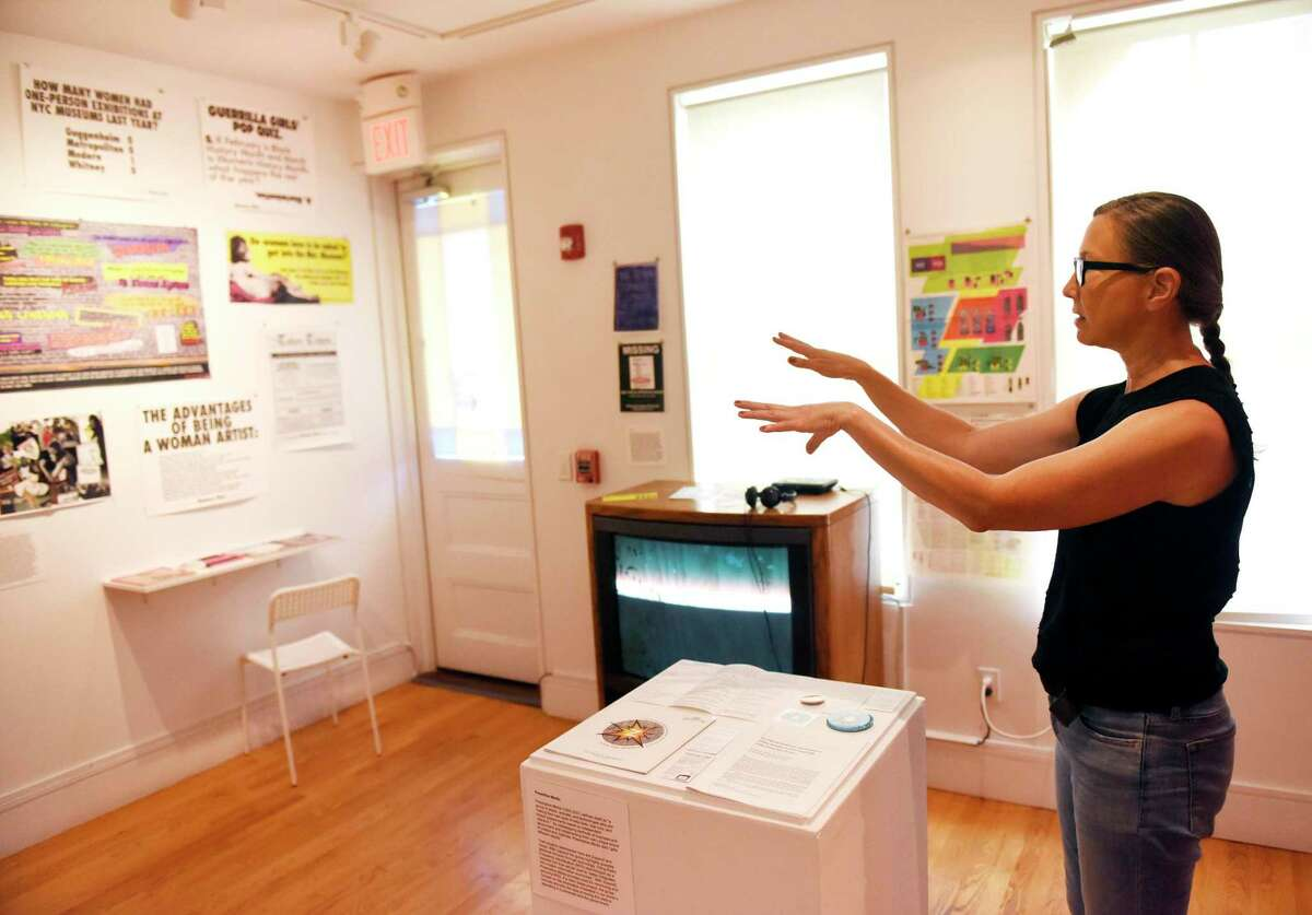 """Creative Director Terri C. Smith shows the """"Collective Action Archive: Redux"""" exhibition at Franklin Street Works in Stamford, Conn., on June 24, 2019. In June 2020, Franklin Street announced that it was permanently closing in response to the coronavirus crisis."""