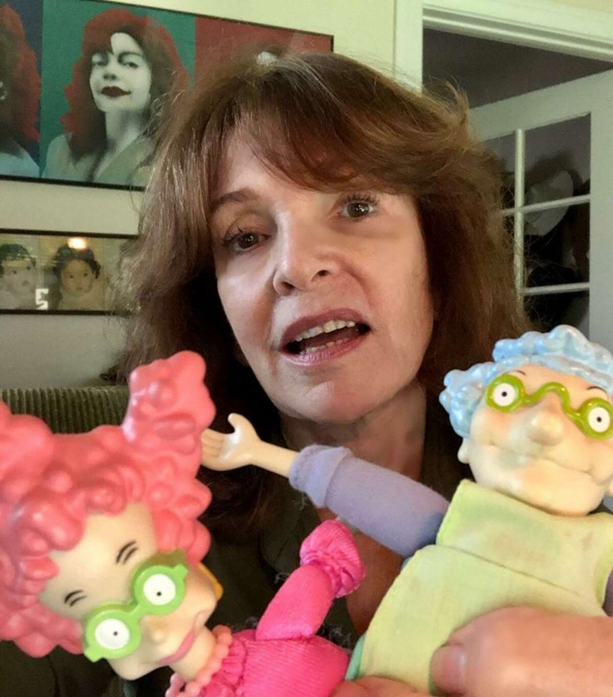 Actress Melanie Chartoff, 71, of Los Angeles, holds two Rugrats characters that she helped make famous with her voice, Didi Pickles on the left and Didi's mother, Minka, on the right.