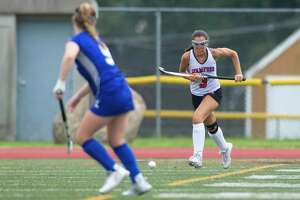 Stamford High School junior Devon Yaghmaie sprints upfield with the ball during a varsity field hockey game against Fairfield Ludlowe High School at Boyle Stadium in Stamford, Conn. on Monday, Sept. 17, 2018.