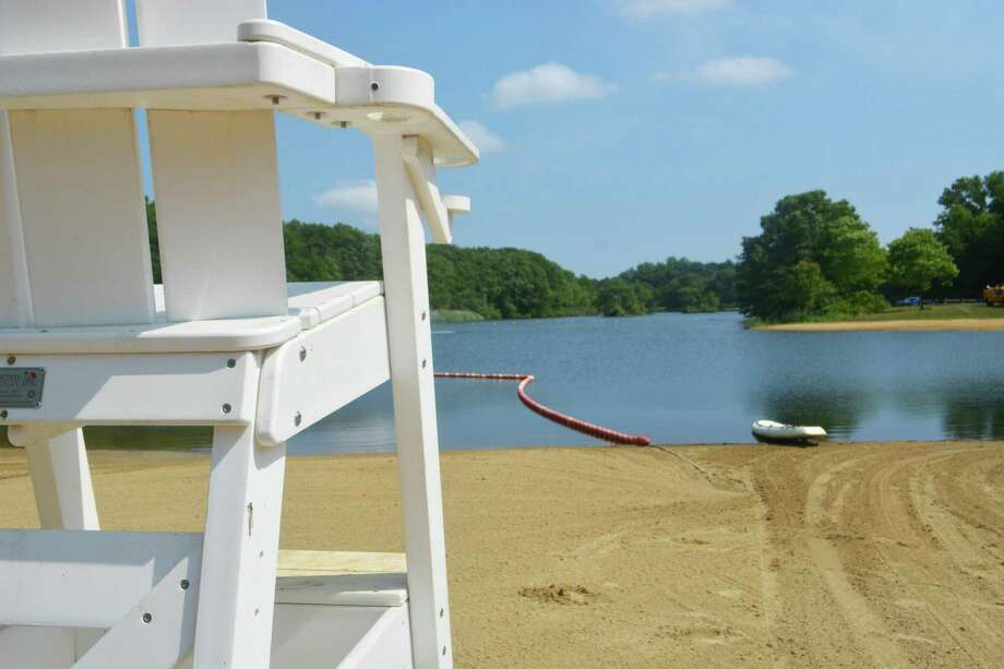 The beach at Crystal Lake on Livingston Road in Middletown is ready for resident visitors and swimmers, who can swim for free daily from 10 a.m. to 7 p.m. Photo: Cassandra Day / Hearst Connecticut Media