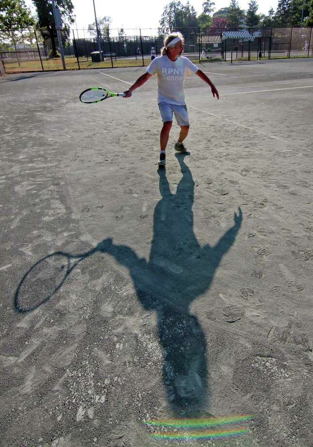 Lloyd Clarmen, of Westport, plays tennis at the Longshore Club Park Tennis Courts in Westport, Conn., on Tuesday June 23, 2020. Photo: Christian Abraham / Hearst Connecticut Media / Connecticut Post