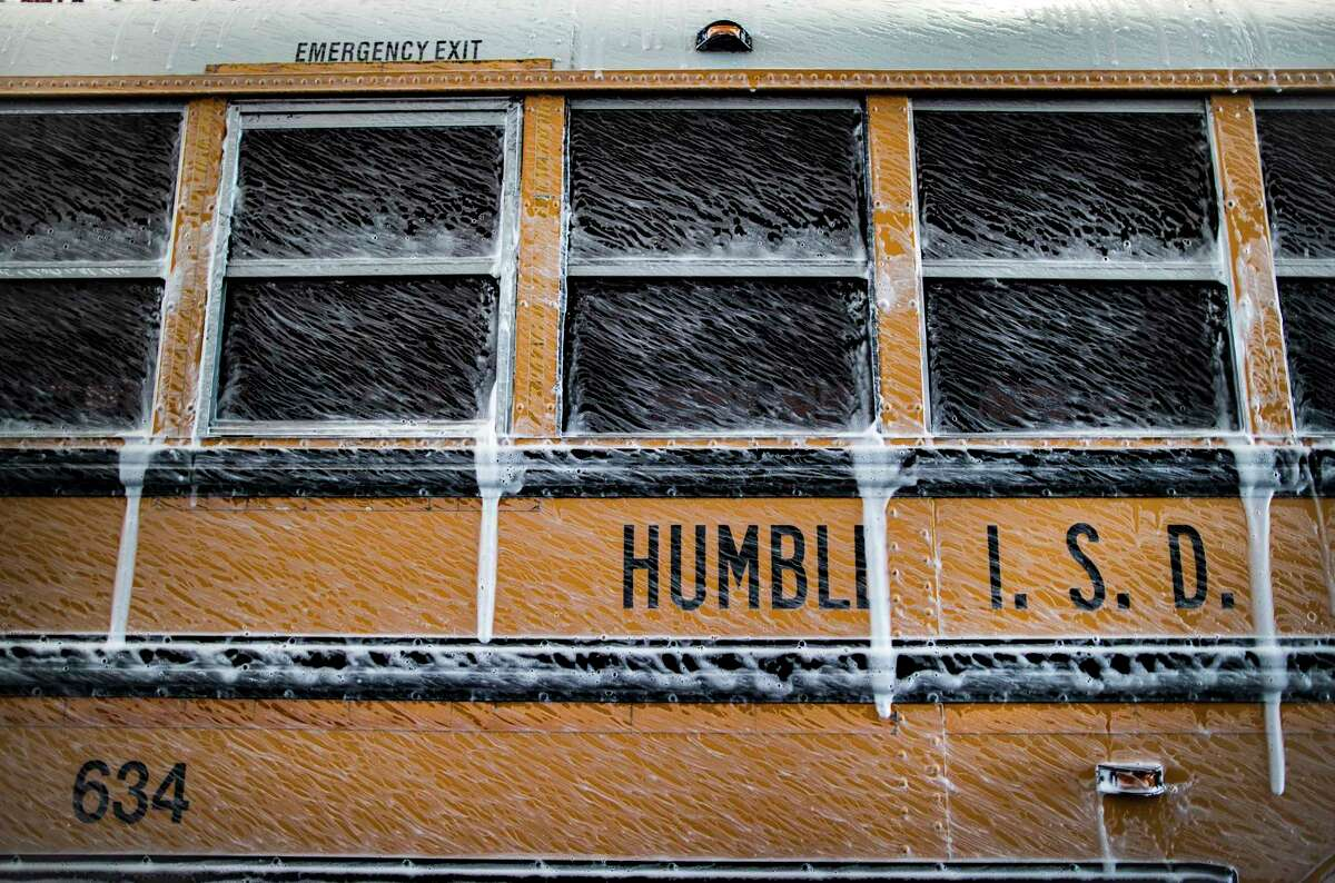 An Humble ISD school bus gets a wash on Thursday, June 11, 2020, in Humble in preparation for the new school year.