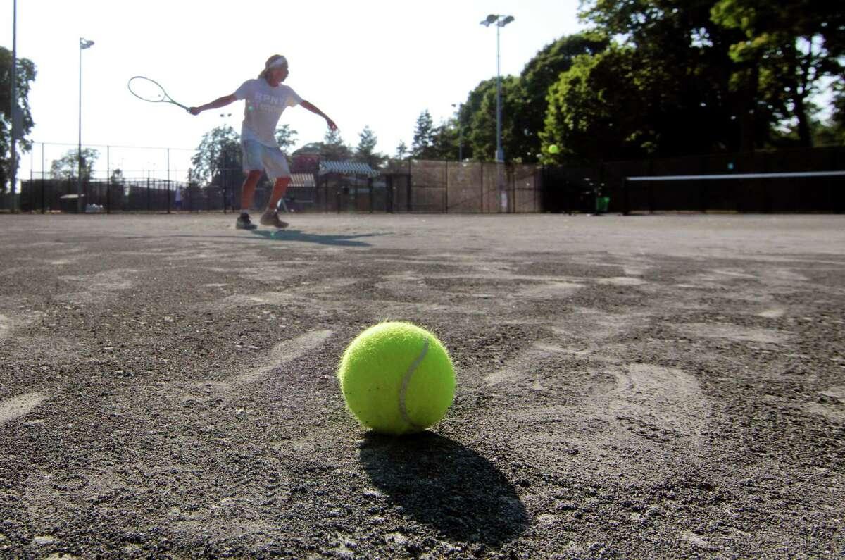 Lloyd Clarmen, of Westport, plays tennis at the Longshore Club Park Tennis Courts in Westport, Conn., on Tuesday June 23, 2020.