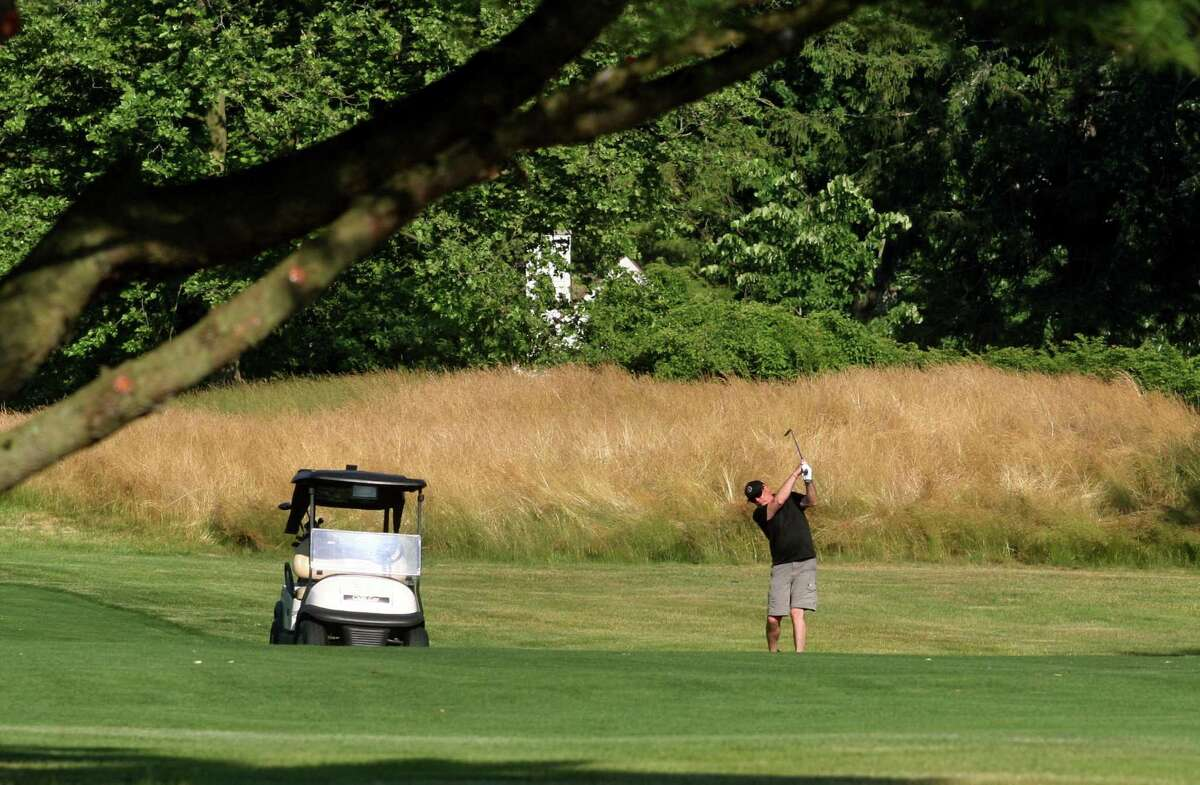 Golfers play a round at Longshore Golf Course in Westport, Conn., on Tuesday June 23, 2020.