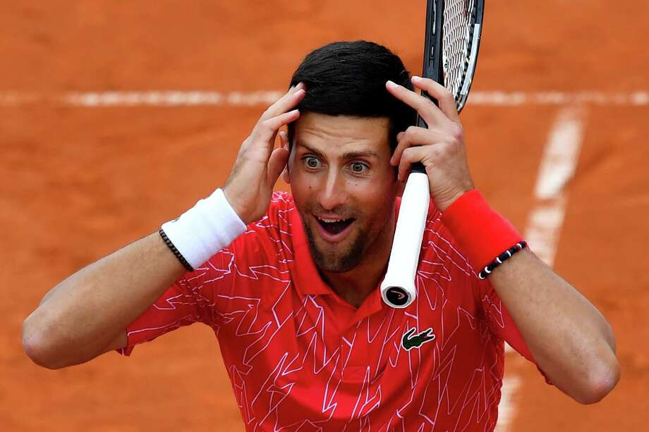Serbia's Novak Djokovic reacts as he takes part in tennis match during a charity exhibition hosted by him, in Belgrade on June 12, 2020. - Novak Djokovic has also tested positive for coronavirus on June 23, 2020 along with Grigor Dimitrov, Borna Coric and Viktor Troicki, after taking part in an exhibition tennis tournament in the Balkans featuring world number one Novak Djokovic, raising questions over the sport's planned return in August. (Photo by Andrej ISAKOVIC / AFP) (Photo by ANDREJ ISAKOVIC/AFP via Getty Images) Photo: ANDREJ ISAKOVIC / AFP or licensors