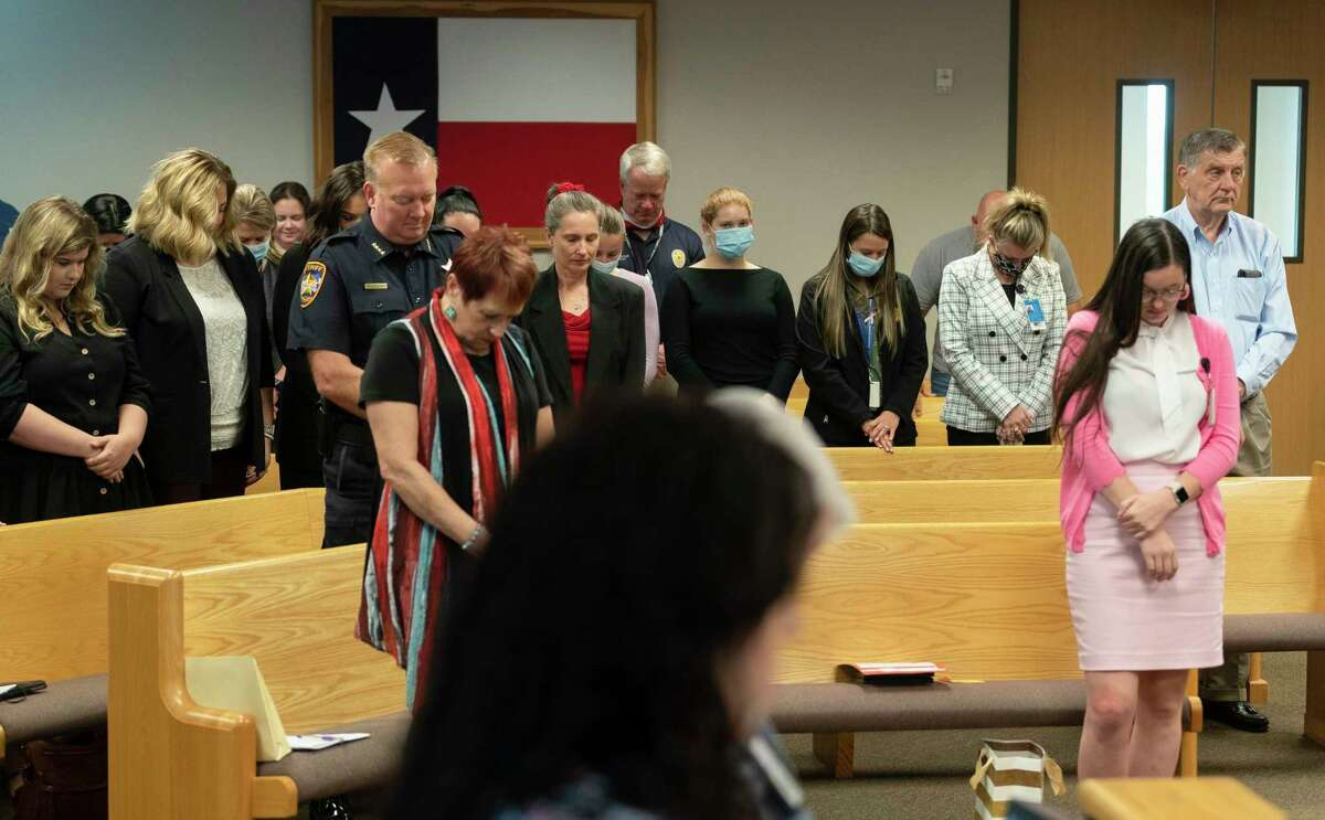 Attendees at a Montgomery County Commissioners Court meeting are seen with a mix of people wearing masks and adhering to social distancing at the Alan B. Sadler Commissioners Court Building, Tuesday, June 23, 2020, in Conroe.