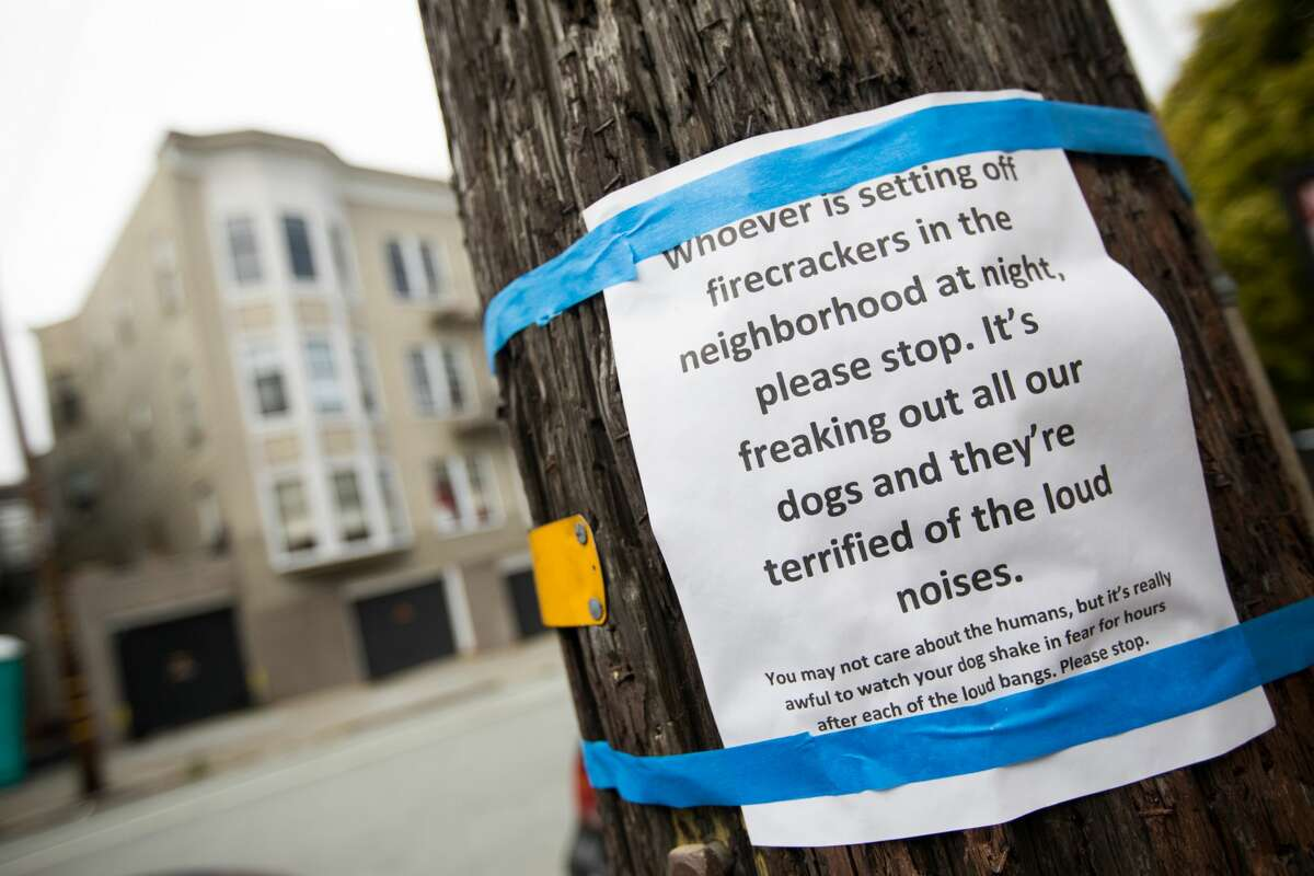 A sign posted to a telephone pole on Page Street between Webster and Buchanan complains about nightly fireworks in San Francisco.