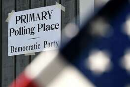 Signs for Tuesday's state primary election are posted at the Mt. Moriah Christian Academy polling station on Tuesday, June 23, 2020, in Glenmont, N.Y. (Will Waldron/Times Union)