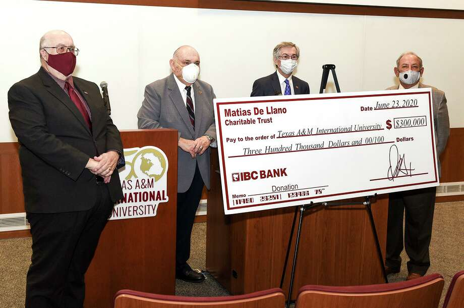 TAMIU president Dr. Pablo Arenaz and IBC Bank Trust Committee representatives Larry Norton, Doug Howland and Rudolph Miles gather for a photo as the Matias De Llano Trust donated $300,000 to TAMIU on Tuesday, June 23 at the TAMIU Academic Innovation Center Auditorium. Photo: Danny Zaragoza / Laredo Morning Times