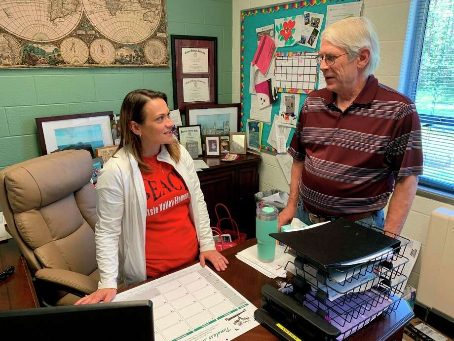 Amiee Erfourth, Principal at Betsy Valley Elementary School, Thompsonville, discuses Blessings in a Backpack plans for the 2020-21 school year with Rev. Skip Comer, chairman of Benzie Blessings in a Backpack. (Submitted photo)