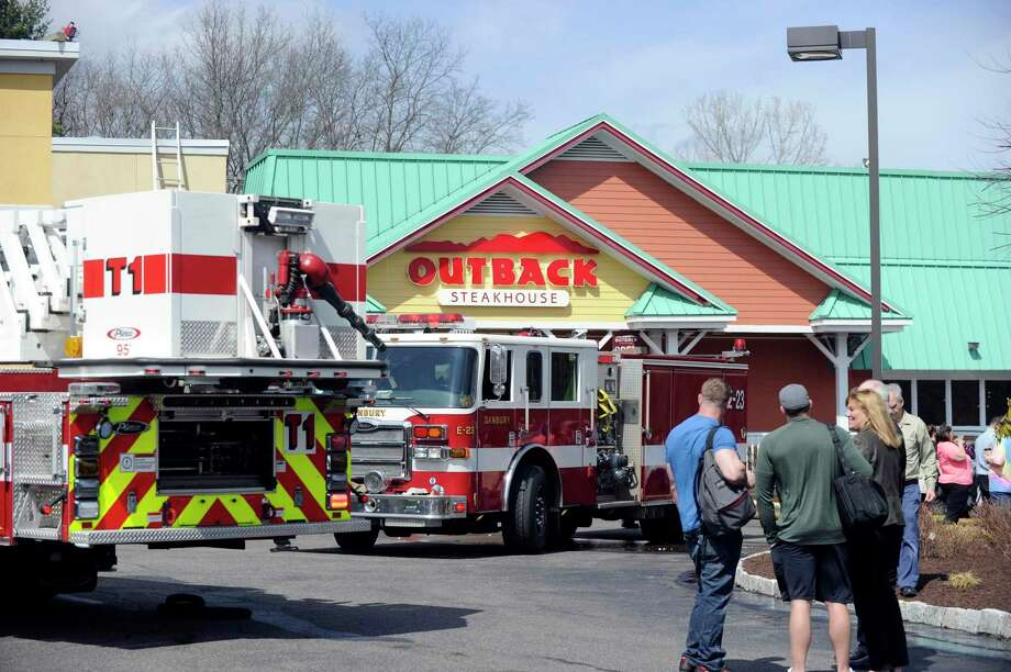 Danbury firefighters respond in 2016 to a call at La Quinta Inn & Suites, with the adjacent Outback Steakhouse pictured. Outback has closed the location permanently as of June 2020, as reported by I-95 Rock, with the chain having seven other restaurants in Connecticut. Photo: Carol Kaliff / Hearst Connecticut Media / The News-Times