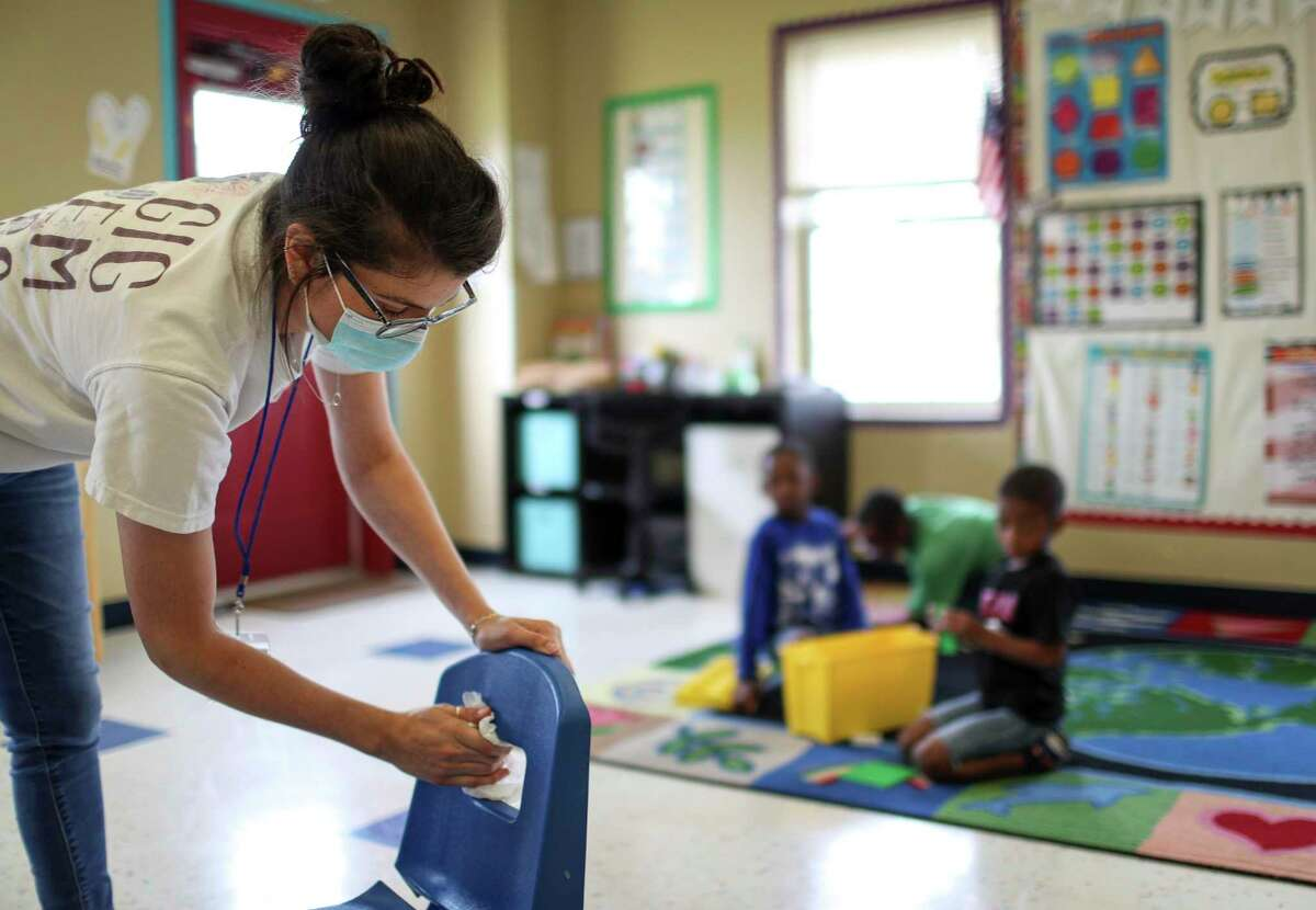 Julia Revelli, a lead teacher for the after school program at Little Academy of Humble, cleans her classroom Tuesday, June 23, 2020, at the school in Humble. Revelli's students range in age from 5 years old to 10 years old.