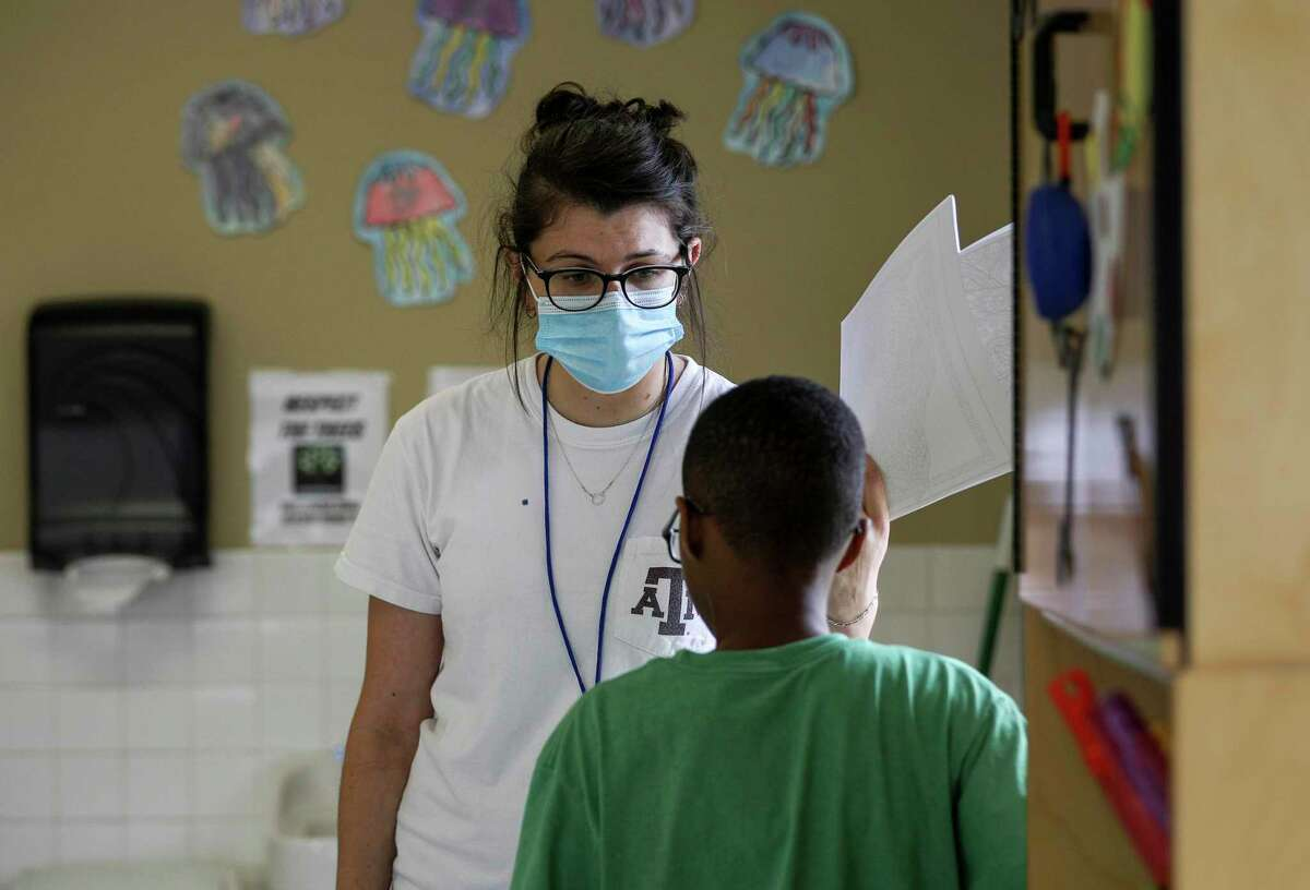 Julia Revelli, a lead teacher for the after school program at Little Academy of Humble, talks to a student while cleaning her classroom Tuesday, June 23, 2020, at the school in Humble. Revelli's students range in age from 5 years old to 10 years old.