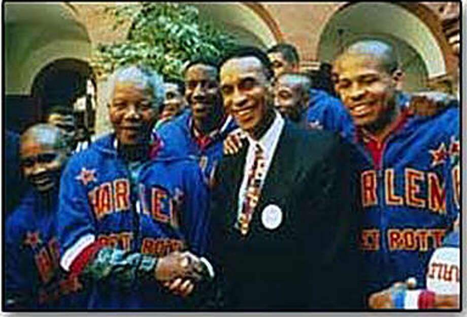 Mannie Jackson, middle, meets with South African President Nelson Mandela, left, while Jackson was the owner of the Harlem Globetrotters. Photo: For The Intelligencer