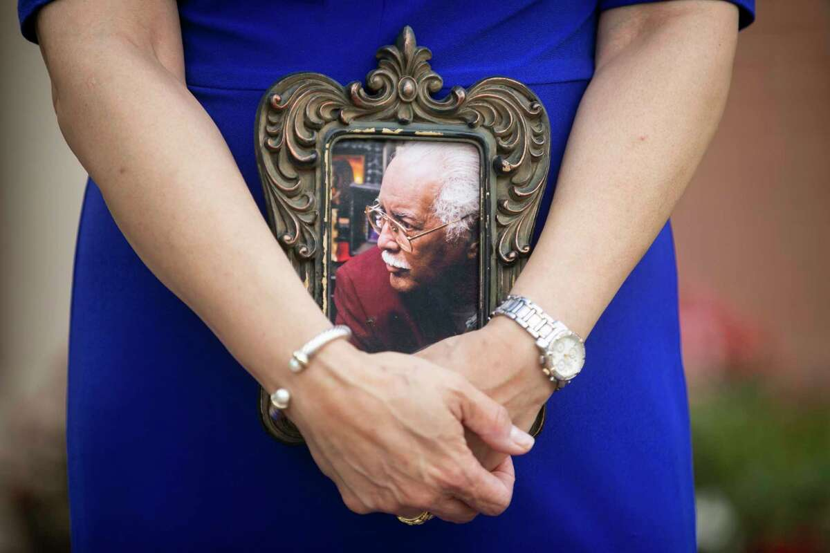 Houston-based Unity Bank CEO Laurie Vignaud poses with a picture of her father, Buddy, a respected business owner in New Orleans and died one year ago, on Wednesday, June 3, 2020. Vignaud credits him for teaching her to work hard and giving her the strength throughout her life.