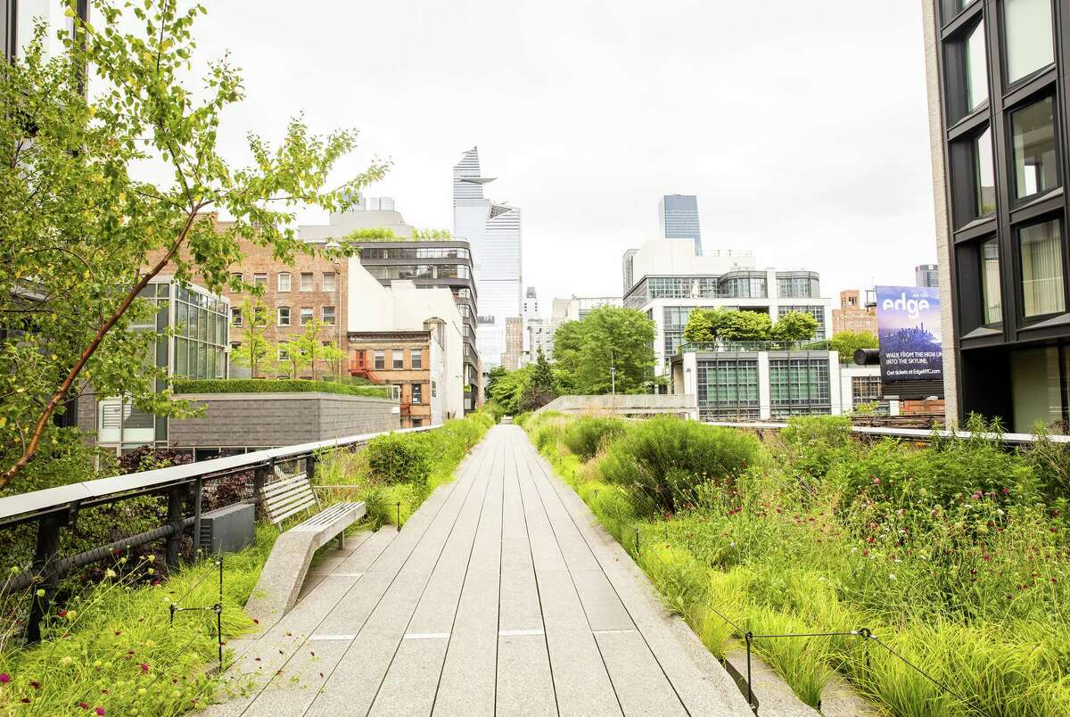 Most of the main walkway of New York City's High Line is only eight feet wide, posing a challenge to its reopening.