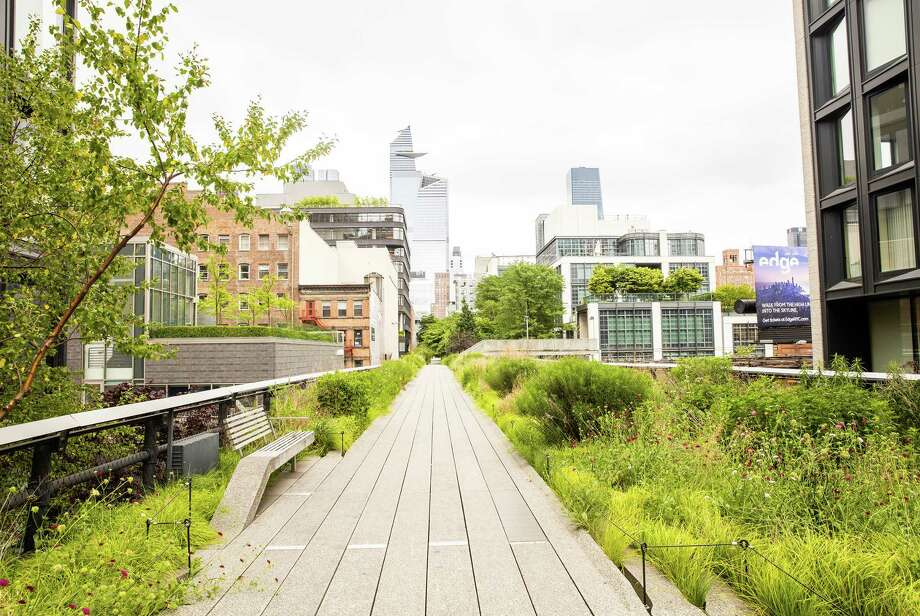 Most of the main walkway of New York City's High Line is only eight feet wide, posing a challenge to its reopening. Photo: Photo For The Washington Post By Hatnim Lee / Hatnim Lee