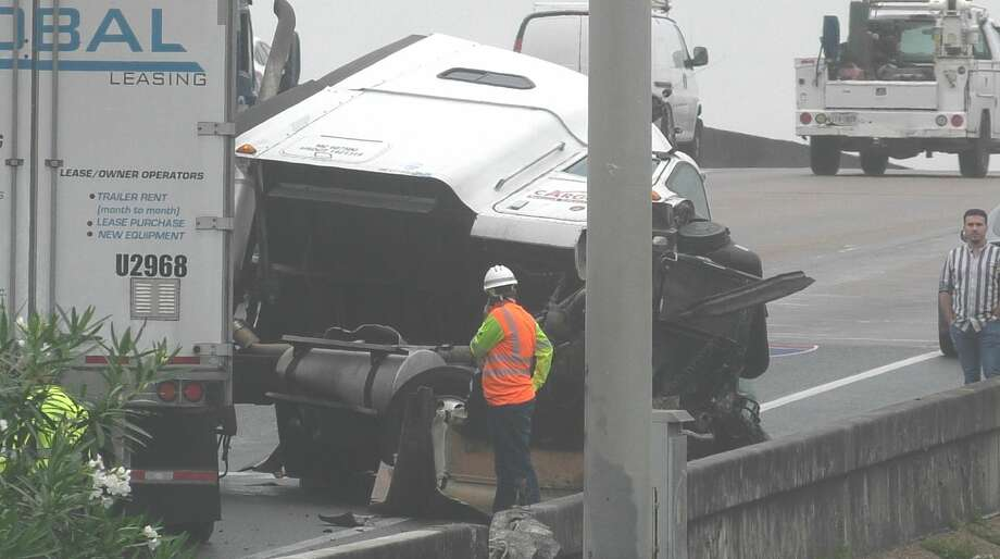 Houston police investigate an 18-wheeler crash along the North Freeway near Crosstimbers on Wednesday, June 24, 2020. Photo: Jay R. Jordan / Houston Chronicle