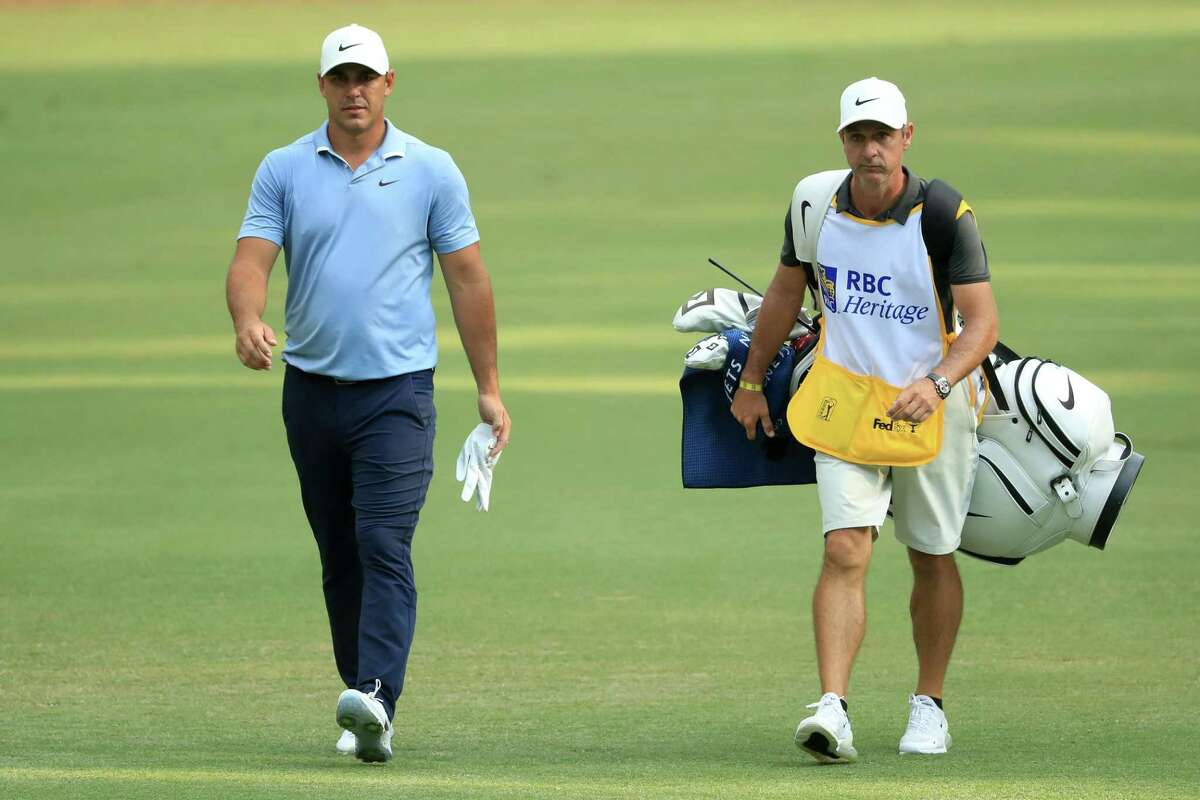 Brooks Koepka of the United States walks with his caddie Ricky Elliott on the 15th hole during the final round of the RBC Heritage on June 21, 2020 at Harbour Town Golf Links in Hilton Head Island, South Carolina.