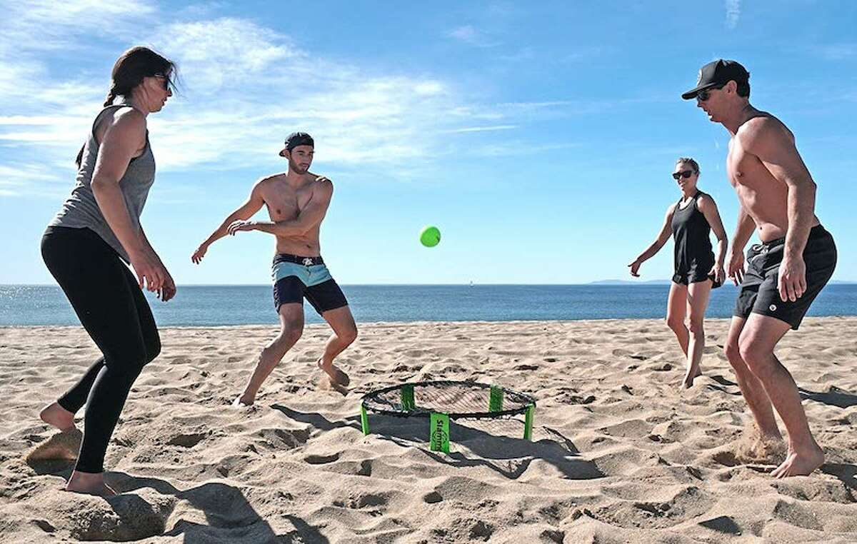GoSports Slammo Game Set Price: $19.99 1,935 Reviews, 4 Stars If you've been to the beach in the last year or two, you might have seen people playing Slammo. It has spiked in popularity recently and can be played on the beach, in your yard, at tailgates, and more. Slammo is a 2-on-2 volleyball style outdoor game where teams have three hits where they need to bounce or spike the ball to the net.
