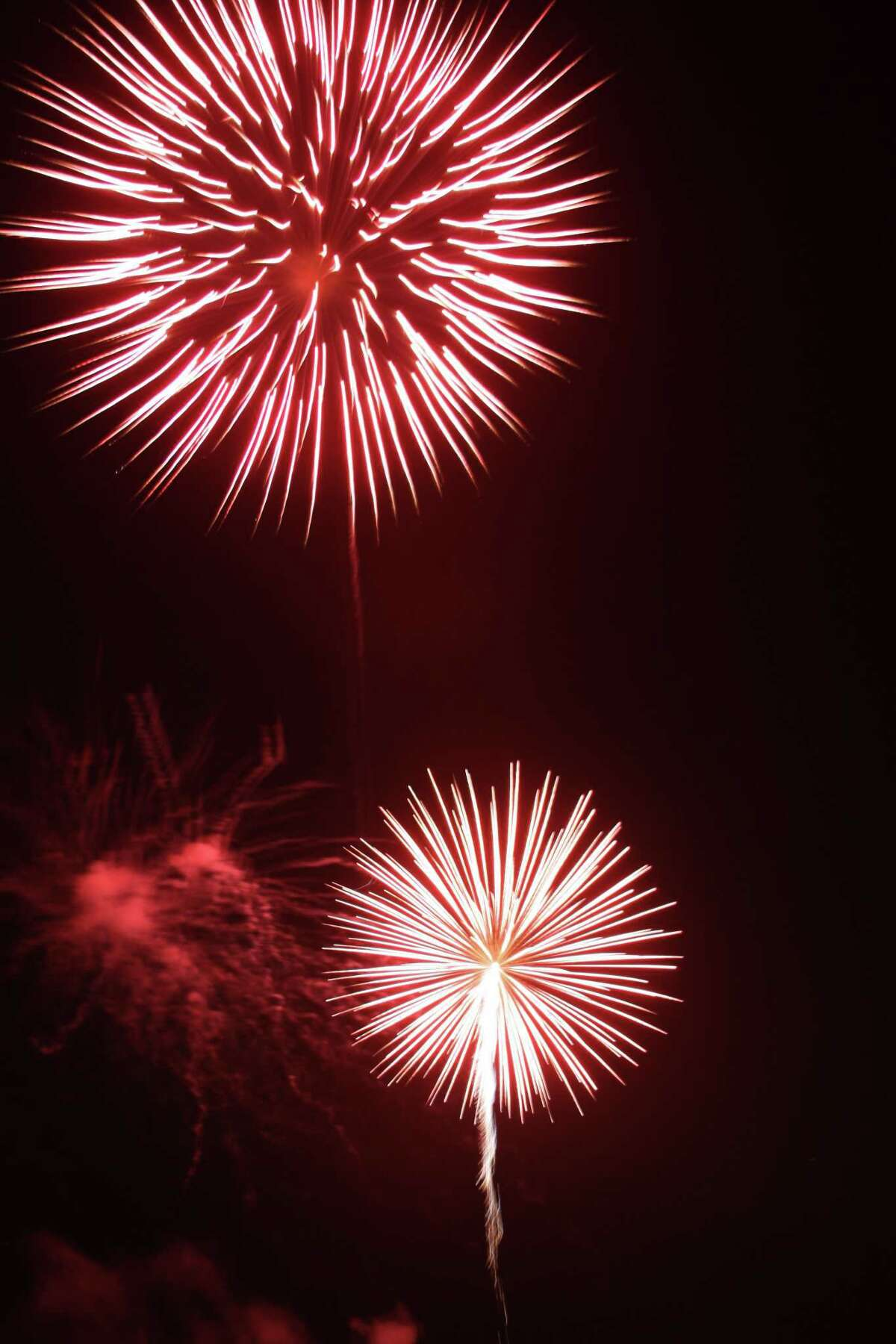 Fireworks explode over New Canaan during one of the town's previous Family Fourth celebrations. The song,